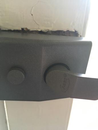 The front door lock inexplicably popped off the door