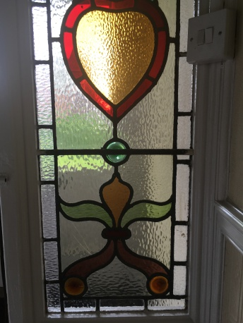 More stained glass in the hallway